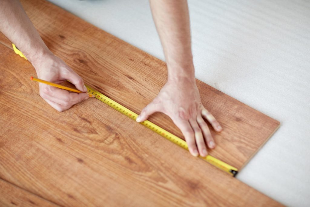 professional flooring expert working on hardwood flooring