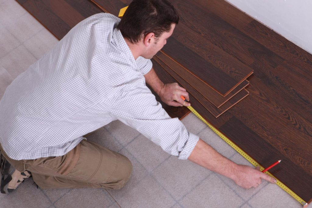 professional flooring expert working