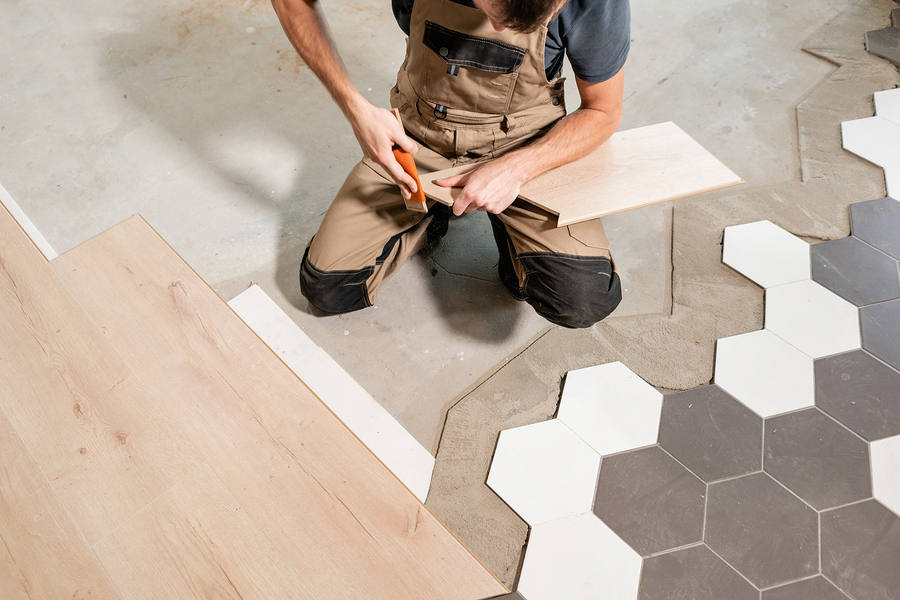 professional flooring expert working on tiles flooring